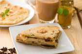 Chapati stacked, Indian flat bread in plate usually served with — Stock Photo