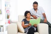 Indian family reading lifestyle photo — Stock Photo