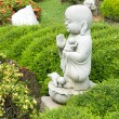 Limestone buddha monk statue — Stock Photo
