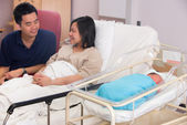 Asian newborn baby girl and daddy in hospital — Stock Photo