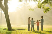 Happy asian family having quality time playing in the outdoor gr — Stock Photo