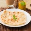 Roti canai flat bread, very famous mamak food in malaysia, usual — Stock Photo