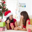 Chinese girl friends during christmas celebration — Stock Photo #26233383
