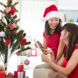 Japanese girl friends during christmas celebration — Stock Photo #26233385