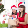 Chinese girl friends during a christmas celebration — Stock Photo #26233397