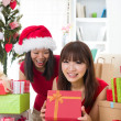 Chinese girl friends during a christmas celebration — Stock Photo #26233417