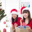 Chinese girl friends during a christmas celebration — Stock Photo #26233453