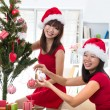 Chinese girl friends during a christmas celebration — Stock Photo