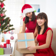 Chinese girl friends during a christmas celebration — Stock Photo #26233499