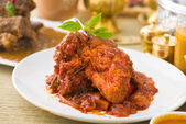 Curry chicken rendang cooked in indian style with spicy sauce an — Stock Photo