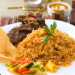 Mutton Biryani rice with traditional items on background — Stock Photo
