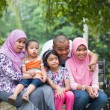 Stock Photo: Happy Malay AsiFamily enjoying family time together in pa