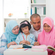 Malay family learning together with lifestyle background — Stock Photo #26599555