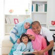Malay family using tablet having a good time surfing internet — Stock Photo
