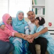 Excited Southeast Asian family at home. Muslim family living lif — Stock Photo