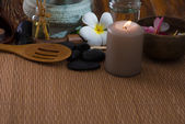 Tropical spa setup with frangipani flower hot rocks and massage — Stock Photo