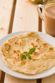 Chapati traditional indian food with traditional items on backgr — Stock Photo