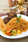 Mutton Biryani rice with traditional items on background — Foto Stock