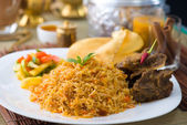 Biryani basmati mutton rice with traditional items on background — Foto Stock