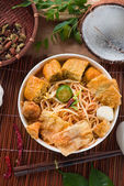 Asam laksa noodle ,Penang style with raw ingredients on backgrou — Stock Photo