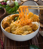 Chopstick and curry noodles with plenty of raw ingredients as ba — Stock Photo