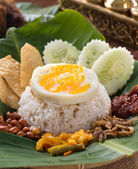 Nasi lemak , malay traditional rice meal served with egg — Stock Photo