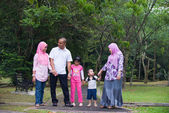 Malay family enjoying quality time outdoor at the park — Stock Photo