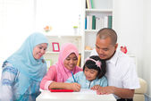 Malay family learning together with lifestyle background — Stock Photo
