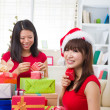 Chinese friends during a christmas celebration — Foto de Stock