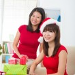 Stockfoto: Chinese friends during a christmas celebration