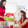 Chinese christmas celebration, two female friends — Stock Photo #26915895