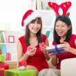 Chinese christmas celebration, two female friends — Stock Photo