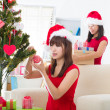 Chinese christmas celebration, two female friends — Stock Photo #26915909