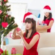 Chinese christmas celebration, two female friends — Stockfoto