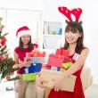 Chinese christmas celebration, two female friends — Stock Photo