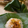 Nasi lemak, a traditional malay curry paste rice dish served on  — Stockfoto