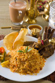 Biryani rice with traditional items on background — Stock Photo