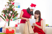 Chinese girls online shopping during christmas celebration — Stock Photo