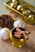 Cinnamon sticks and indian spices with traditional setup decorat — Stock Photo