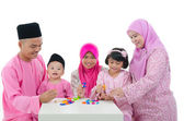 Malay family playing and having quality time during hari raya — Stok fotoğraf