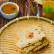 Постер, плакат: Indian flat bread called Chapati with vegetable curry