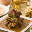 Mutton korma famous food with traditional indian background item — Stock Photo #27241837