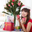 Asian girl during christmas with her presents — Stock Photo #27241843