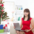 Christmas woman on laptop doing internet shopping. Woman excited — Stock Photo