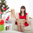 Stock Photo: Christmas womwith xmas gift