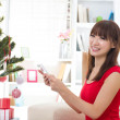 Asian girl during christmas with her presents — Stock Photo