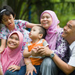 Lifestyle photo of malay family having fun in park ,malaysia — Stock Photo #27242133