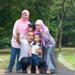 Happy indonesian Family enjoying family time together in the par — Stockfoto