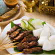 Stock Photo: Thai chicken skewers with lime and chili, on wooden board.