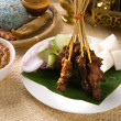 Thai chicken skewers with lime and chili, on wooden board. — Stock Photo